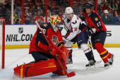 Filip Kuba of the Florida Panthers defends against Nicklas Backstrom of the Washington Capitals as goaltender Scott Clemmensen prepares to stop a...