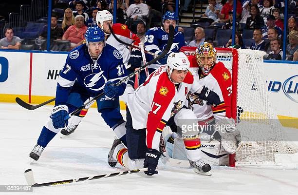 Filip Kuba of the Florida Panthers defends the net with teammate Jacob Markstrom s during the first period of the game at the Tampa Bay Times Forum...