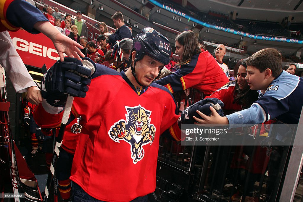 Filip Kuba #17 of the Florida Panthers is greeted by fans prior to the start of the game against the Winnipeg Jets at the BB&T Center on March 8, 2013 in Sunrise, Florida.