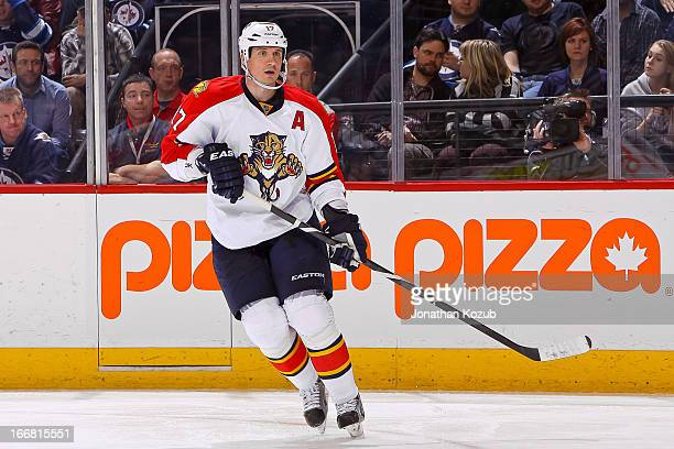 Filip Kuba of the Florida Panthers keeps an eye on the play during the third period against the Winnipeg Jets at the MTS Centre on April 11 2013 in...