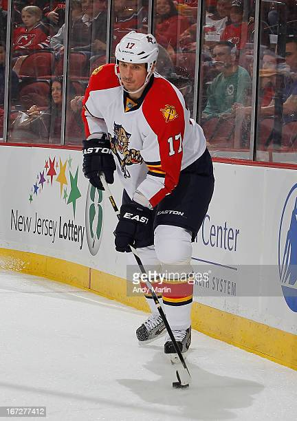 Filip Kuba of the Florida Panthers plays the puck against the New Jersey Devils during the game at the Prudential Center on April 20 2013 in Newark...