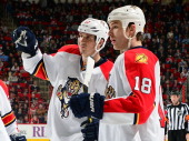 Filip Kuba of the Florida Panthers pumps his first following his secondperiod goal his first of the season as Shawn Matthias looks on during an NHL...