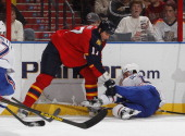 Filip Kuba of the Florida Panthers recieves a penalty for boarding David Desharnais of the Montreal Canadiens at the BBT Center on March 10 2013 in...