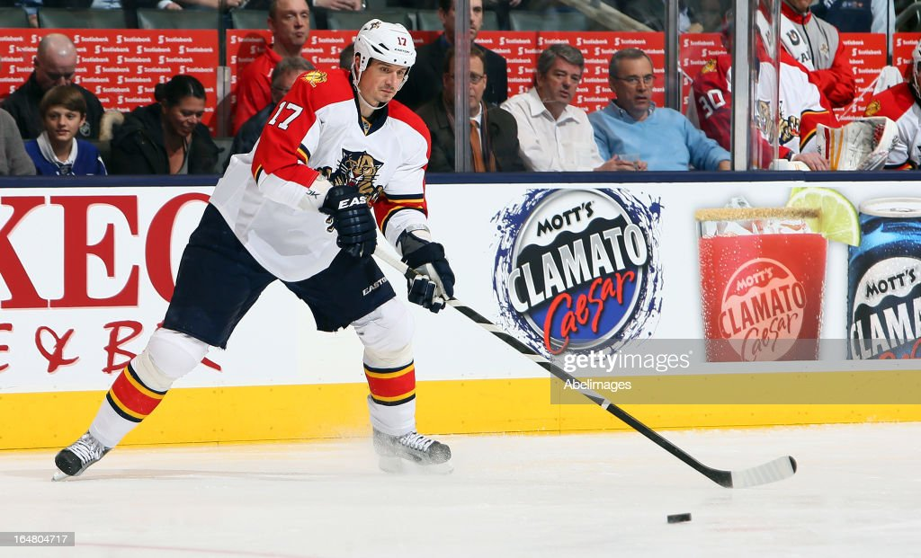 Filip Kuba #17 of the Florida Panthers skates up the ice with the puck during NHL action against the Toronto Maple Leafs at the Air Canada Centre March 26, 2013 in Toronto, Ontario, Canada.