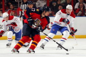 Filip Kuba of the Florida Panthers skates with the puck against Alex Galchenyuk of the Montreal Canadiens at the BBT Center on February 14 2013 in...