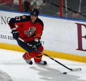 Filip Kuba of the Florida Panthers skates with the puck against the Buffalo Sabres at the BBT Center on February 28 2013 in Sunrise Florida