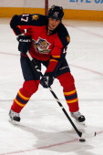 Filip Kuba of the Florida Panthers skates with the puck against the Carolina Hurricanes at the BBT Center on March 3 2013 in Sunrise Florida