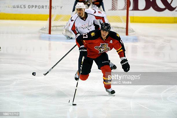 Filip Kuba of the Florida Panthers skates with the puck during a NHL game against the Washington Capitals at the BBT Center on April 6 2013 in...