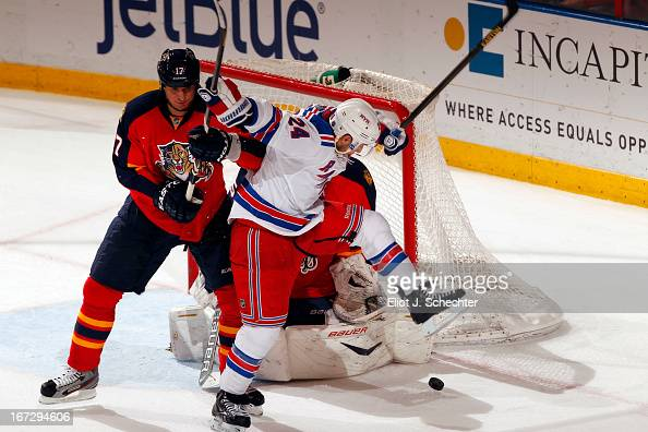 Filip Kuba of the Florida Panthers tangles with Ryan Callahan of the New York Rangers in front of the net at the BBT Center on April 23 2013 in...