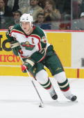 Filip Kuba of the Minnesota Wild skates with the puck during the game against the Vancouver Canucks at General Motors Place on November 2 2005 in...