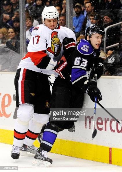 Filip Kuba of the Ottawa Senators checks Scott Parse of the Los Angeles Kings during the third period of the NHL hockey game on December 3 2009 in...