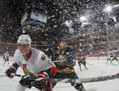 Filip Kuba of the Ottawa Senators is checked by Robyn Regehr of the Buffalo Sabres at the First Niagara Center on November 11 2011 in Buffalo New...