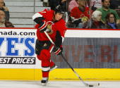 Filip Kuba of the Ottawa Senators looks to make a hard cross ice pass in a game against the Washington Capitals at Scotiabank Place on November 23...