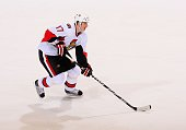 Filip Kuba of the Ottawa Senators skates with the puck during the NHL game against the Phoenix Coyotes at Jobingcom Arena on December 5 2009 in...