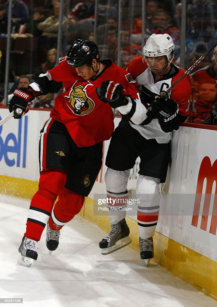 <a gi-track='captionPersonalityLinkClicked' href=/galleries/search?phrase=Filip+Kuba&family=editorial&specificpeople=209425 ng-click='$event.stopPropagation()'>Filip Kuba</a> #17 of the Ottawa Senators throws a bodycheck on Mike Richards #18 of the Philadelphia Flyers in a game at Scotiabank Place on January 3, 2010 in Ottawa, Canada.
