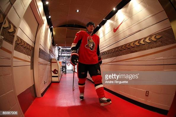 Filip Kuba of the Ottawa Senators walks down the players' tunnel after warmups prior to a game against the New York Islanders at Scotiabank Place on...