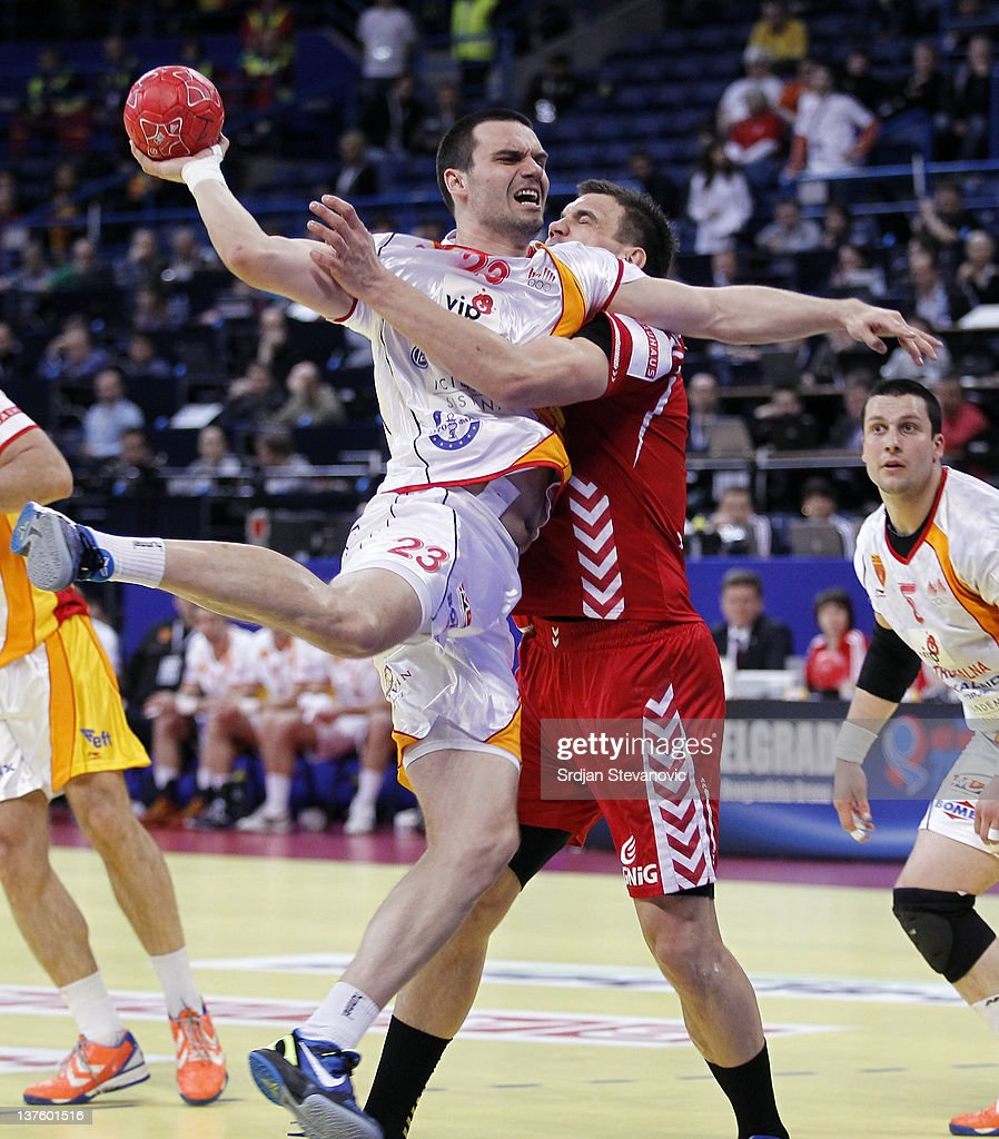 Filip Lazarov (L) of Macedonia competes with Bartosz Jurecki (R) of Poland during the Men's European Handball Championship 2012 second round group one match between Poland and Macedonia, at Arena Hall on January 23, 2012 in Belgrade, Serbia.