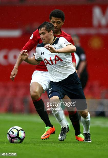 Filip Lesniak of Tottenham Hotspur battles with Devonte Redmond of Manchester United during the Premier League 2 match between Manchester United and...