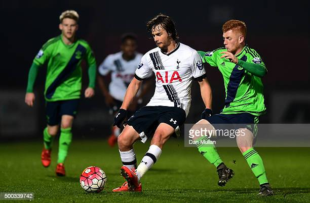 Filip Lesniak of Tottenham Hotspur holds off Harry Reed of Southampton during the Barclays U21 Premier League match between Tottenham Hotspur and...