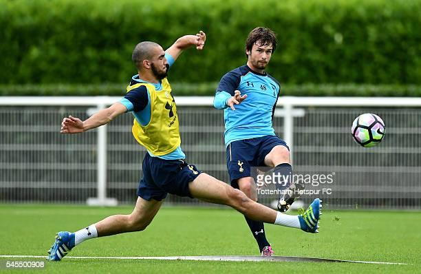 Filip Lesniak of Tottenham Hotspur passes under pressure from Nabil Bentaleb of Tottenham Hotspur during a training session at the Tottenham Hotspur...