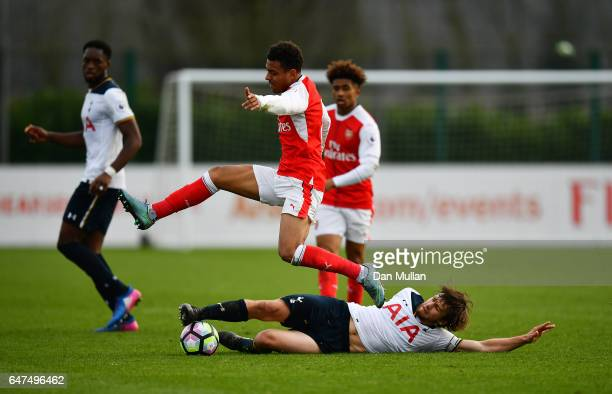 Filip Lesniak of Tottenham Hotspur stretches to tackle Donyell Malen of Arsenal during the Premier League 2 match between Arsenal and Tottenham...