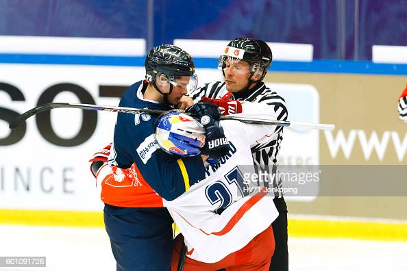 Filip Lestan of HV71 mixes it up with Bobby Raymond of Red Bull Salzburg during the Champions Hockey League match between HV71 Jonkoping and Red Bull...