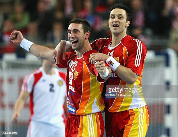 Filip Mirkulovski of Macedonia and Vladimir Temelkov celebrate the 3630 victory after the Men's World Handball Championships match between Macedonia...