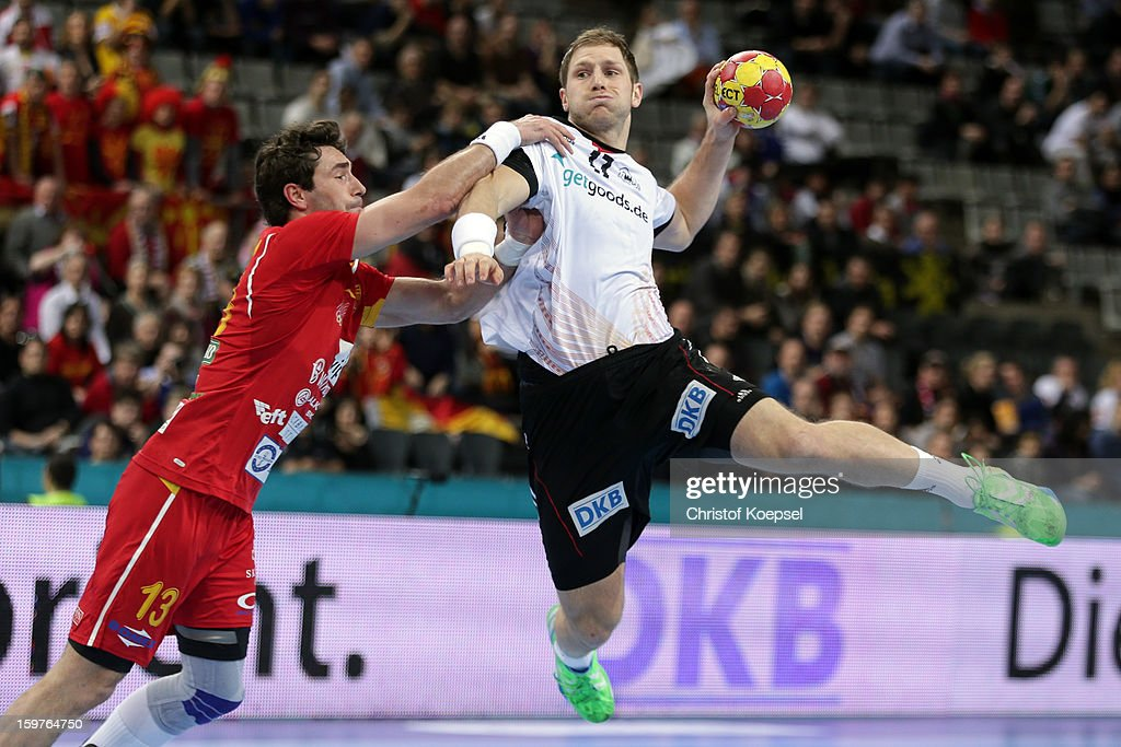 Filip Mirkulovski of Macedonia defends against Steffen Weinhold of Germany during the round of sixteen match between Germany and Macedonia at Palau Sant Jordi on January 20, 2013 in Barcelona, Spain.