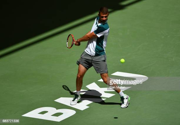 Filip Nikolic of Azerbaijan plays a backhand against Georgiy Pochay of Turkmenistan in the Mens Tennis Singles first round match during day five of...