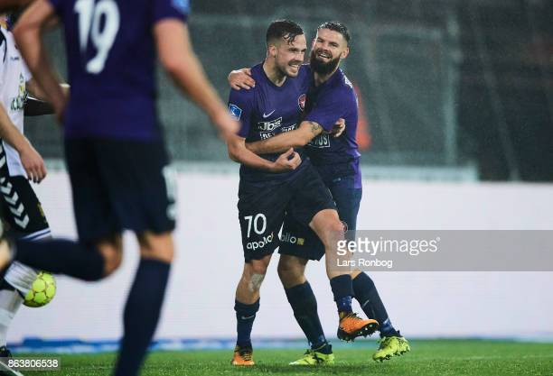 Filip Novak and Marc Dal Hende of FC Midtjylland celebrate after scoring their second goal during the Danish Alka Superliga match between FC...