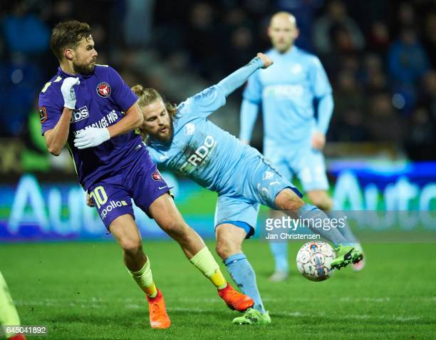 Filip Novak of FC Midtjylland and Kasper Fisker of Randers FC compete for the ball during the Danish Alka Superliga match between Randers FC and FC...