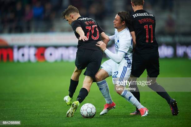 Filip Novak of FC Midtjylland Peter Ankersen of FC Copenhagen and Andreas Cornelius of FC Copenhagen compete for the ball during the Danish Alka...