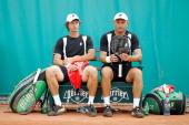 Filip Polasek of Slovakia and Martin Damm of Czech Republic discuss tactics during their men's doubles first round match between Martin Damm of Czech...