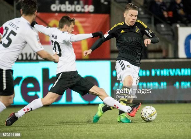 Filip Rogic of Orebro SK Robert Taylor of AIK during the Allsvenskan match between Orebro SK AIK at Behrn Arena on November 5 2017 in Orebro Sweden