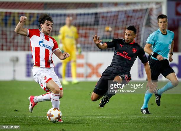 Filip Stojkovic of Crvena Zvezda iis challenged by Francis Coquelin of Arsenal during the UEFA Europa League group H match between Crvena Zvezda and...