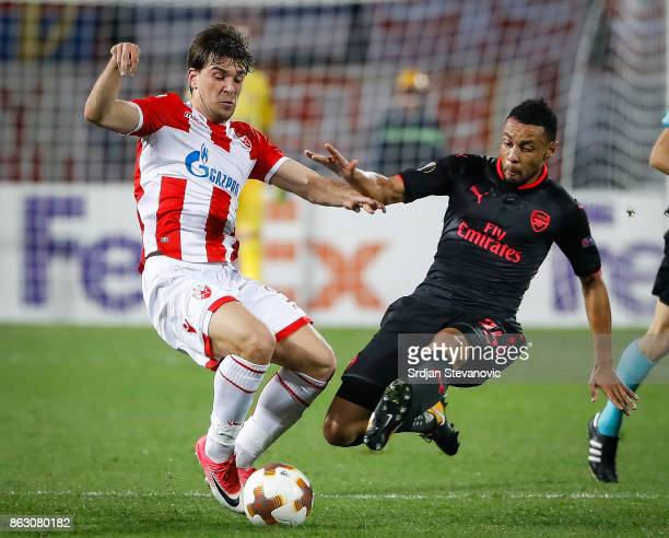 Filip Stojkovic of Crvena Zvezda is challenged by Francis Coquelin of Arsenal during the UEFA Europa League group H match between Crvena Zvezda and...