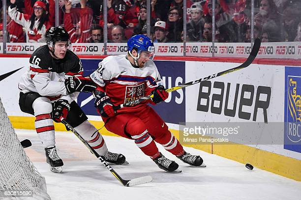 Filip Suchy of Team Czech Republic and Taylor Raddysh of Team Canada skate after the puck during the 2017 IIHF World Junior Championship quarterfinal...