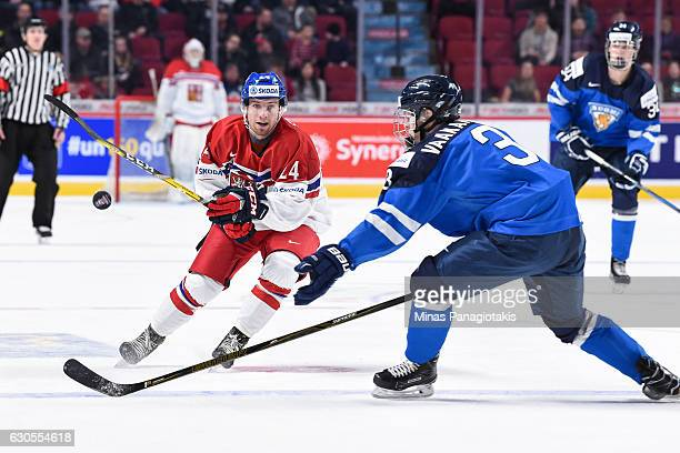 Filip Suchy of Team Czech Republic dumps the puck past Urho Vaakanainen of Team Finland during the IIHF World Junior Championship preliminary round...