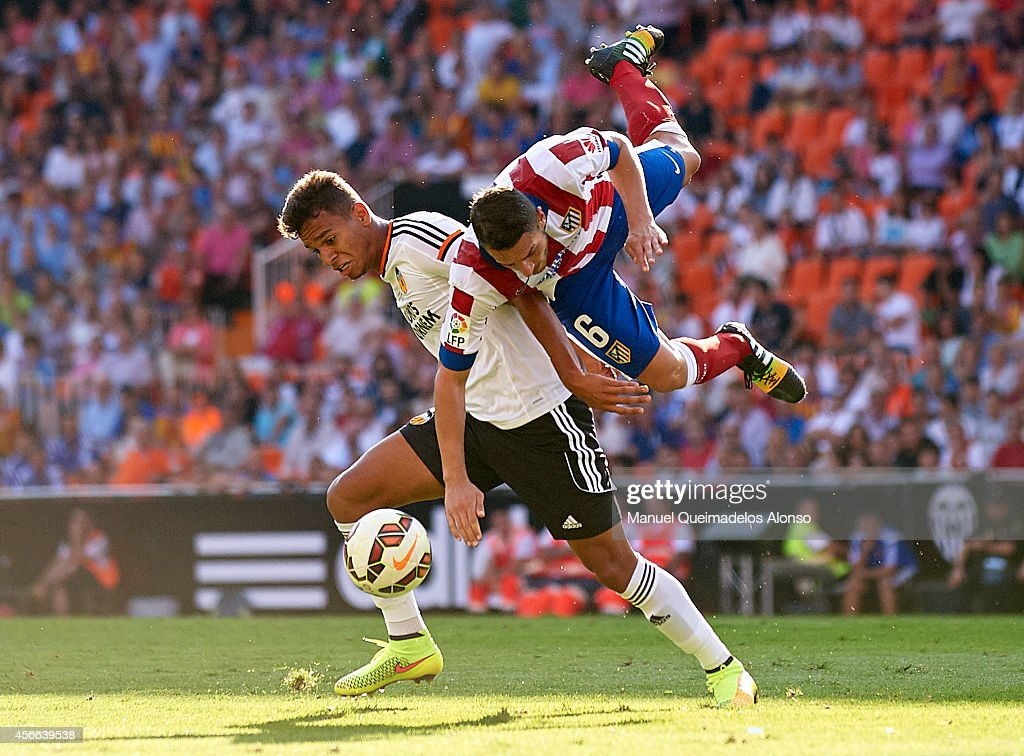 Filipe Augusto of Valencia competes for the ball with Koke of Atletico de Madrid during the La Liga match between Valencia CF and Club Atletico de...