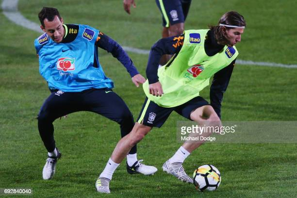 Filipe Luis controls the ball from Rodriguinho of Brazil during a Brazil training session at Lakeside Stadium on June 6 2017 in Melbourne Australia