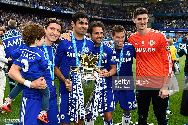 Filipe Luis Diego Costa Cesc Fabregas Cesar Azpilicueta and Thibaut Courtois of Chelsea celebrate with the trophy after the Barclays Premier League...