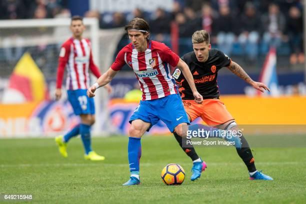 Filipe Luis of Atletico de Madrid competes for the ball with Santiago Mina Lorenzo Santi Mina of Valencia CF during the match Atletico de Madrid vs...