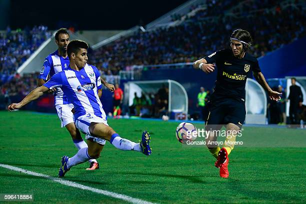 Filipe Luis of Atletico de Madrid competes for the ball with Unai Bustinza of Deportivo Leganes during the La Liga match between Club Deportivo...