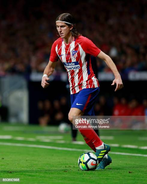 Filipe Luis of Atletico de Madrid controls the ball during the La Liga match between Club Atletico Madrid and Malaga CF at Estadio Wanda...