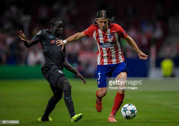Filipe Luis of Atletico de Madrid fights for the ball with N'Golo Kante of Chelsea FC during the UEFA Champions League 201718 match between Atletico...