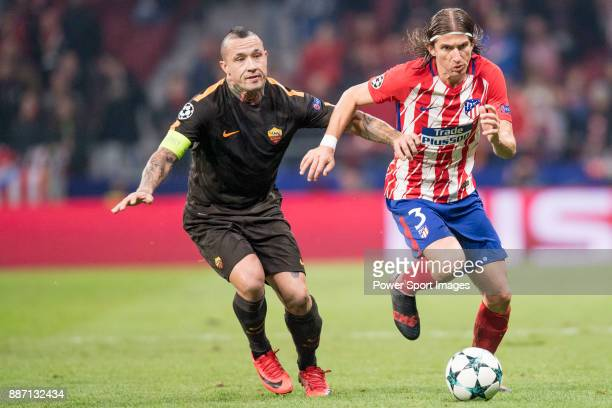 Filipe Luis of Atletico de Madrid flights the ball with Radja Nainggolan of AS Roma during the UEFA Champions League 201718 match between Atletico de...