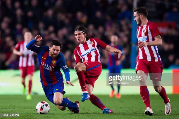 Filipe Luis of Atletico de Madrid fouls Lionel Messi of FC Barcelona during the Copa del Rey semifinal second leg match between FC Barcelona and...