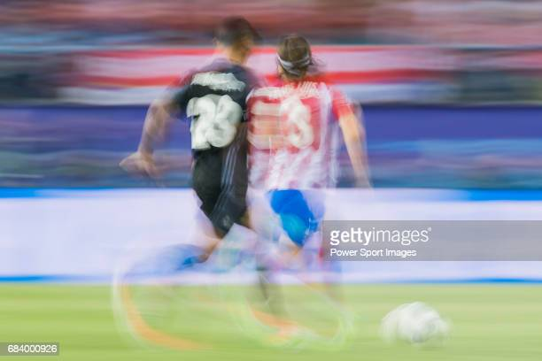 Filipe Luis of Atletico de Madrid is followed by Danilo Luiz Da Silva of Real Madrid during their 201617 UEFA Champions League Semifinals 2nd leg...