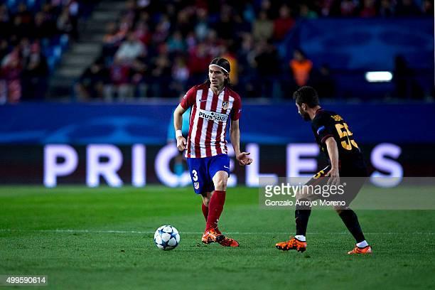 Filipe Luis of Atletico de Madrid kicks the ball behind Sabri Sariouglu of Galatasaray AS during the UEFA Champions League Group C match between Club...