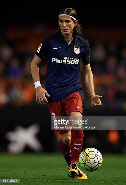 Filipe Luis of Atletico de Madrid runs with the ball during the La Liga match between Valencia CF and Atletico de Madrid at Estadi de Mestalla on...